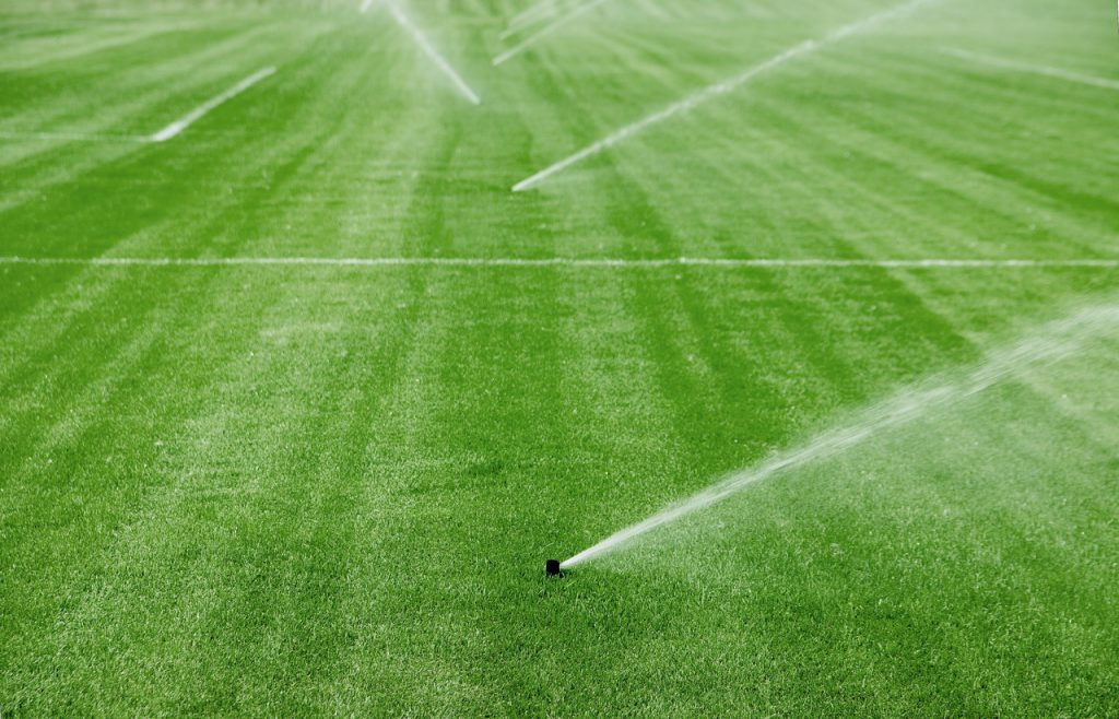 Sprinkler System For Soccer Field --- Image by © Royalty-Free/Corbis
